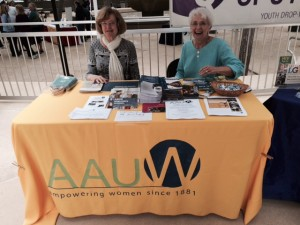 Nancy McCabe and Ruth Burgess work an AAUW at a recent state worker function