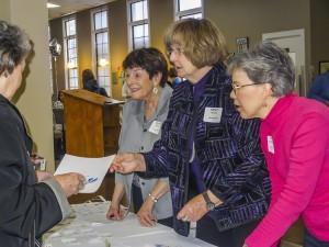 Registration Desk with Cherril Peabody, Nancy McCabe & Gina Schumacher